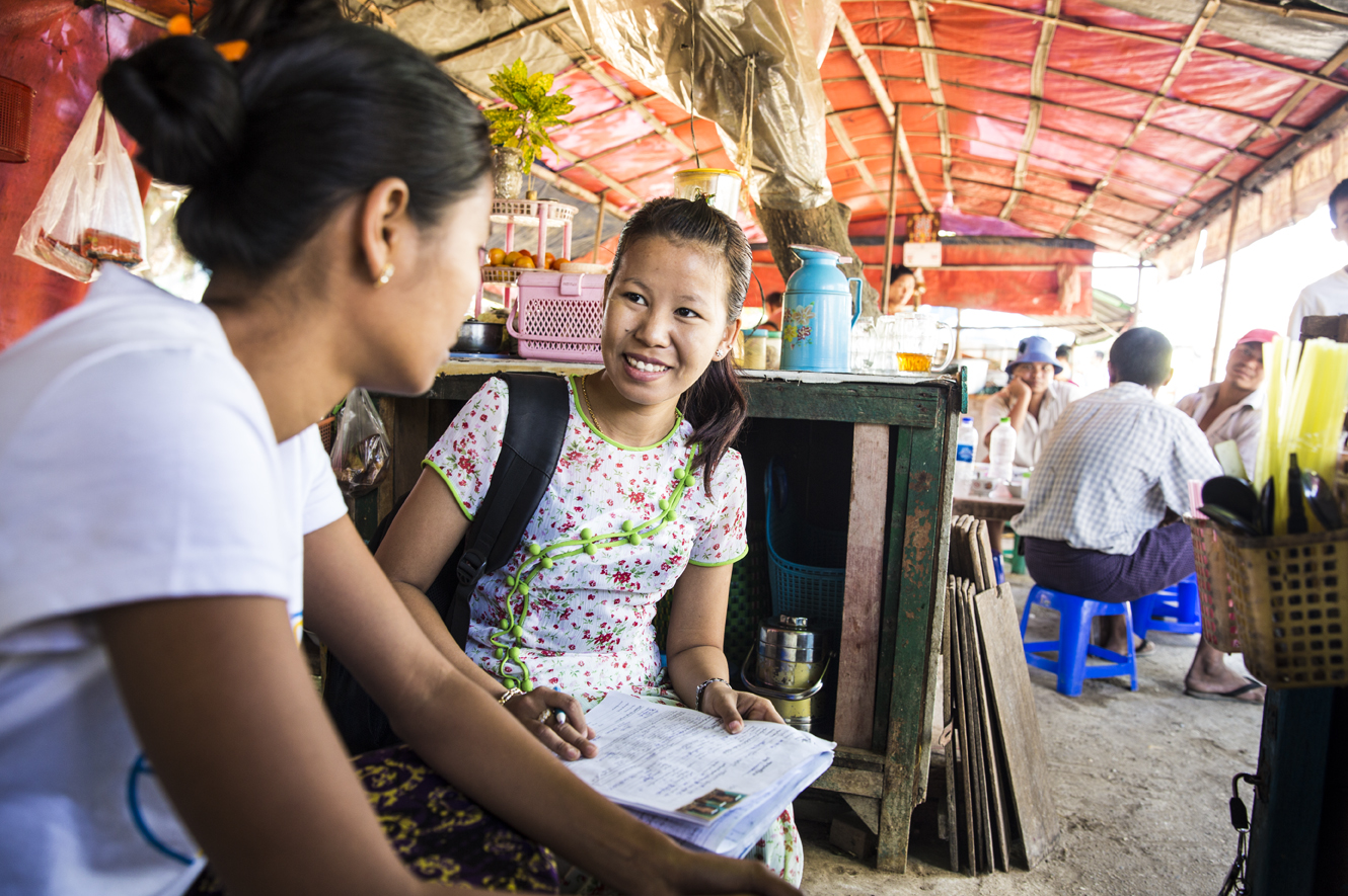 Aye Aye Myint, a loan officer with DAWN Microfinance, can now spend more time in the field with clients and less time sorting through paperwork.