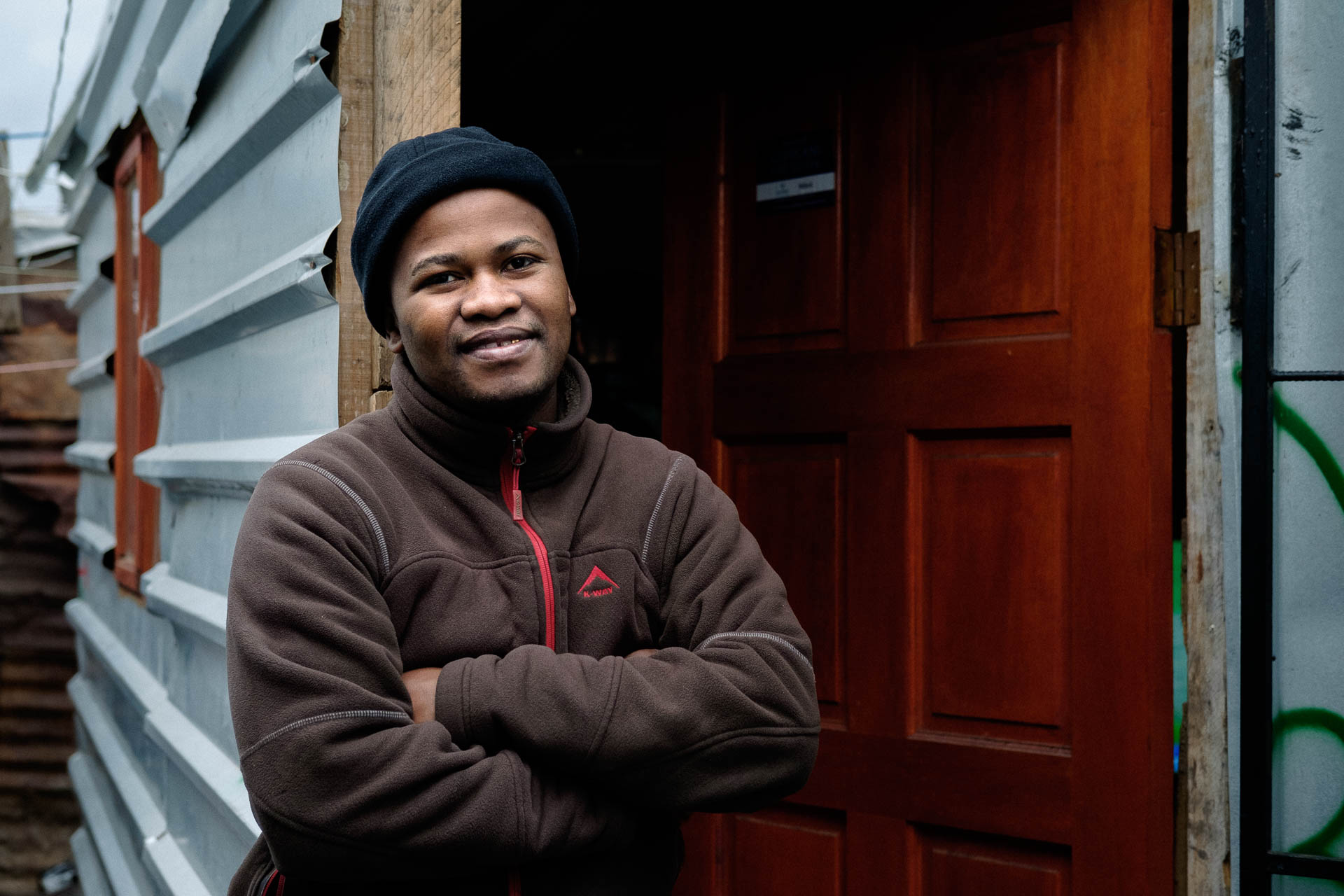Siphumelele, a client of Lumkani, has fire protection and insurance even though he lives in an informal settlement.
