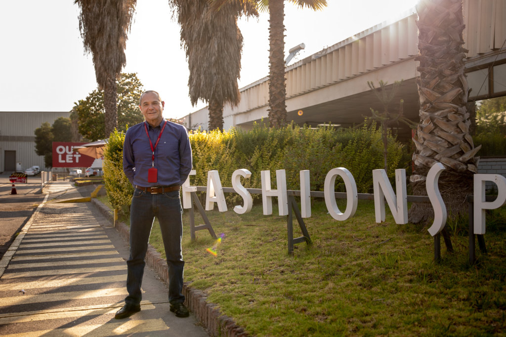 Fernando Rocchi outside in front of the Fashions Park sign
