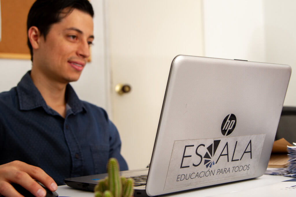 Escala employee working on his computer