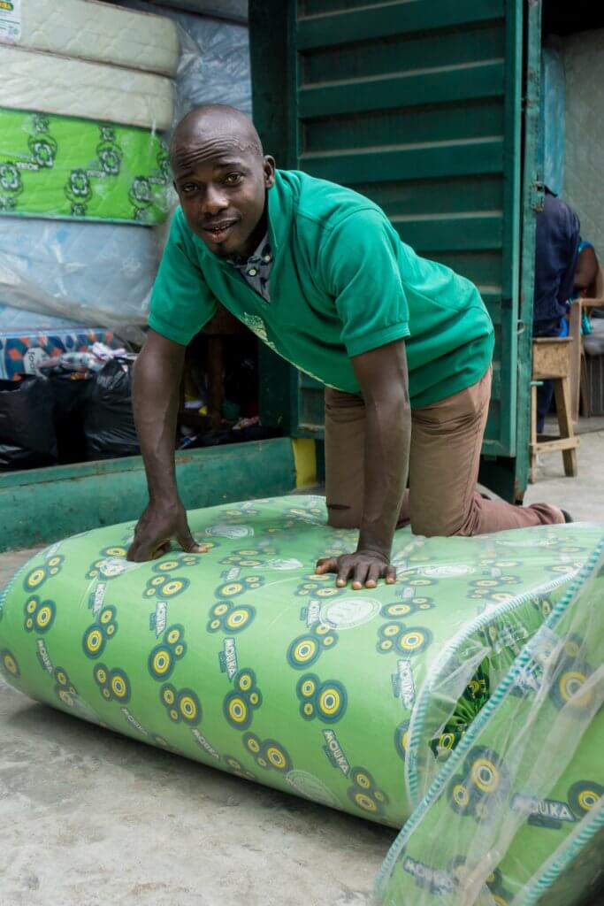 Mr. Ononyia with a mattress