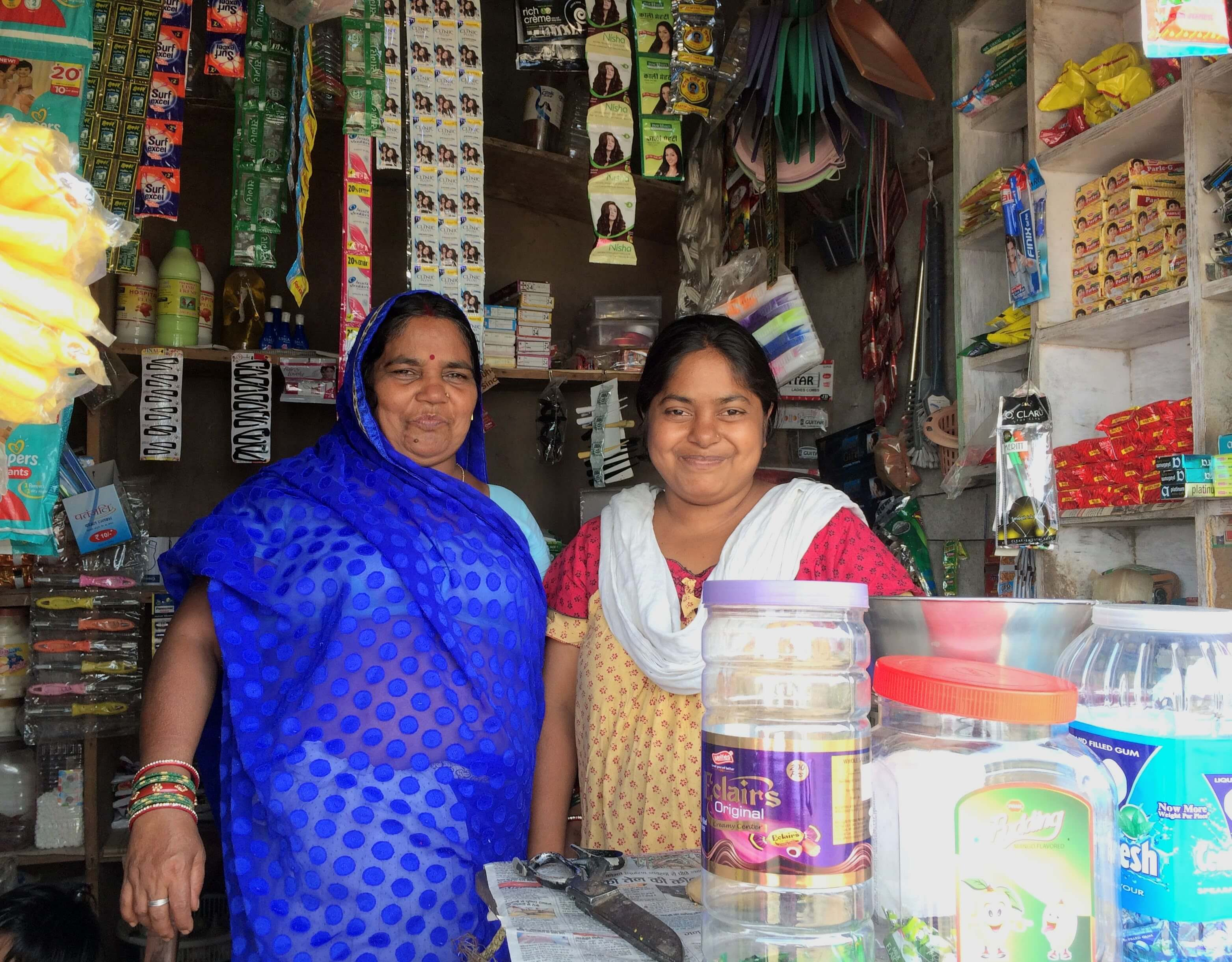 Kamini Kashyap runs a grocery store and a tailoring business just outside of Bilaspur. She joined a Joint Liability Group, where seven women offer each other support and share small business loans from RBL Bank, facilitated by BASIX Sub-K. Her first loan helped her launch tailoring business by buying a sewing machine and materials.