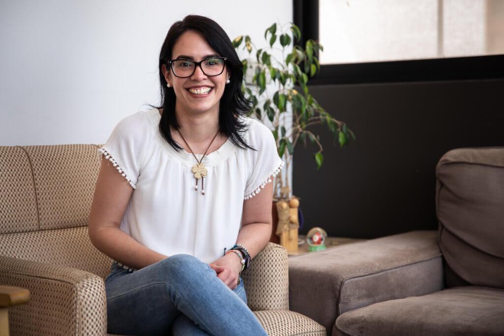 Virginia Chacón sitting inside Destacame's office