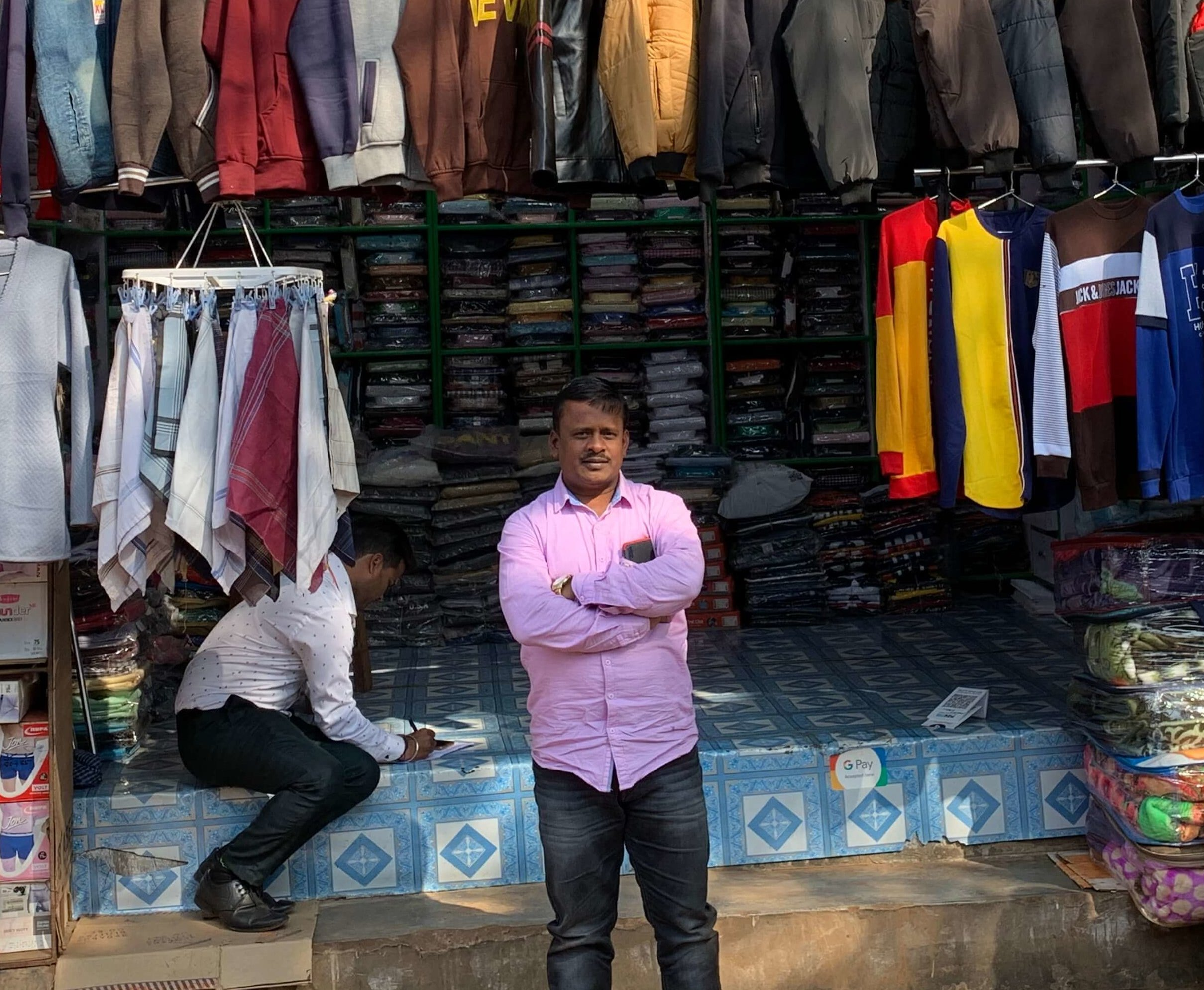 Mohammed Ishaqe and his brother run five clothing stores in the busy market area of Khurda. To know which products to stock, he follows the latest trends in the market. He currently has two loans from Annapurna Finance and another bank, which he used for purchasing items for his businesses from Kolkata. He accepts digital payments and uses a handwritten book for sales and purchase records. He is satisfied with the growth he and his family have achieved with the business and hopes to expand his businesses further in the future.