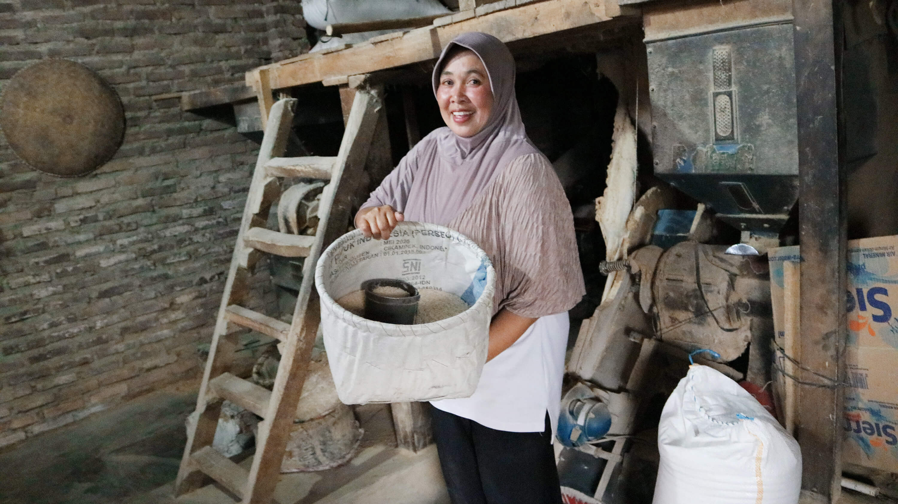 "Ibu Oom owns a rice mill with her family in the village of Majalaya, West Java. She joined BAV's Joint Liability Group in 2017 to access working capital to purchase more unhusked rice to be milled. She told us, ""I managed to increase the amount of unhusked rice to be milled every week and witnessed a positive growth in my family's rice milling business."" In the future, she hopes that her loan amount will increase and that she will have more information about the market so that she can expand her business."