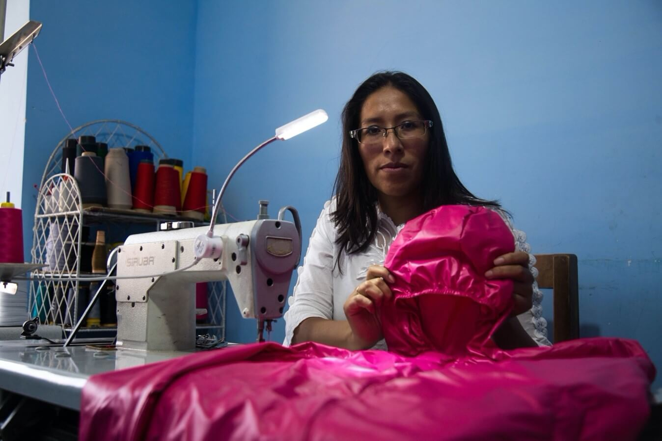 When the pandemic closed schools and sporting events, demand plummeted for the uniforms Carolina Cano Huanca produced through her garment business in La Paz, Bolivia. With support from Accion's partner BancoSol, Carolina quickly pivoted to produce personal protective equipment to help her community stay safe.