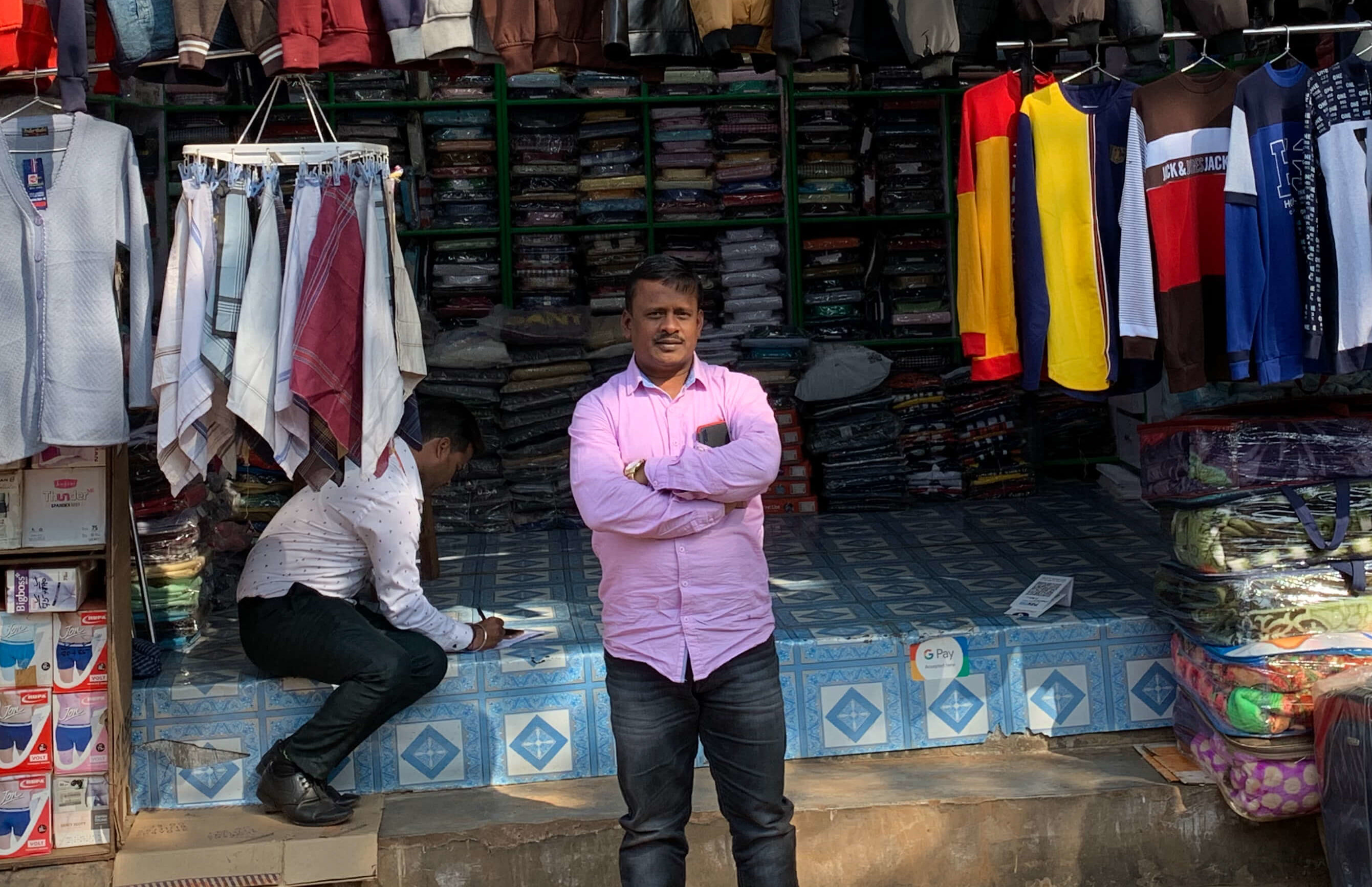 Mohammed Ishaqe and his brother run five clothing stores in the busy market area of Khurda. He currently has two loans from Annapurna Finance (AFPL) and another bank, which he used for purchasing items for his businesses from