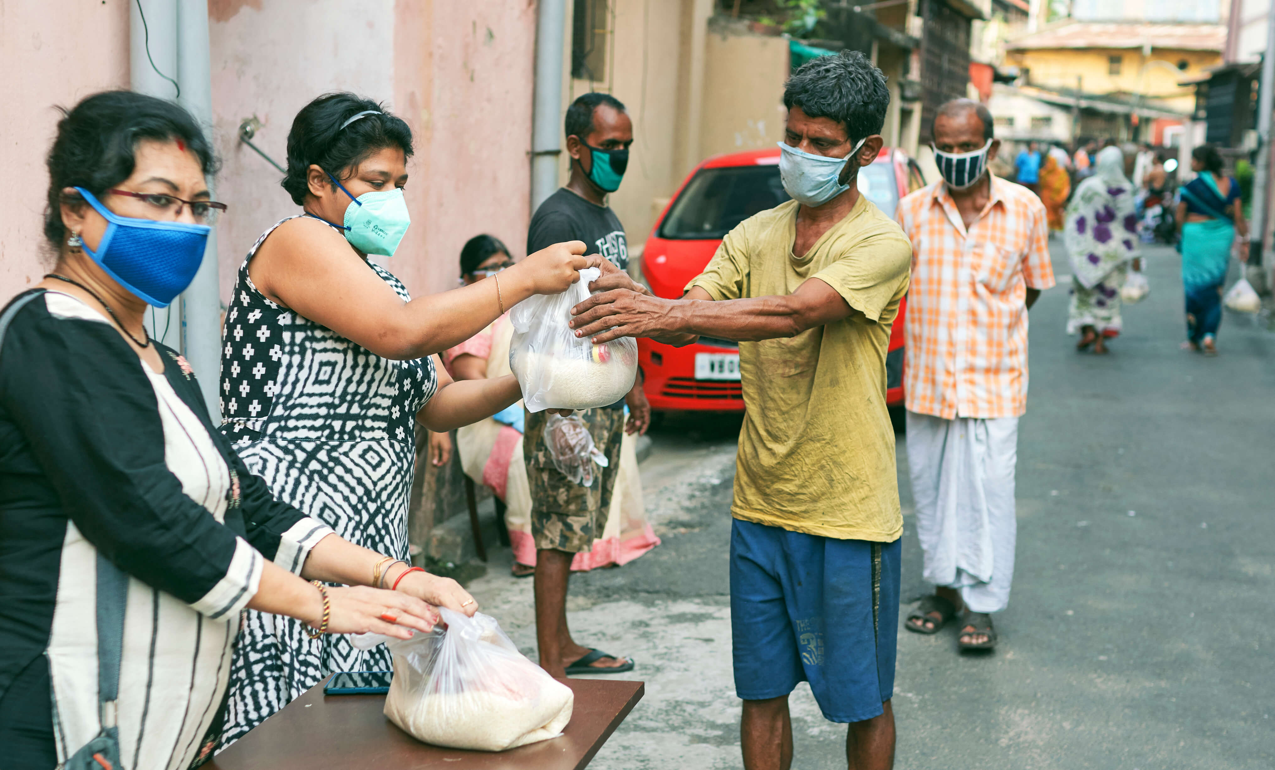 Civic volunteers responding to COVID-19 hand out groceries in Kolkata, India. Photo by Suprabhat Dutta.
