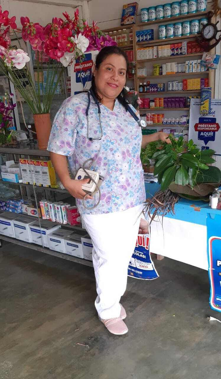 Jovita stands in the health center that she opened in her rural community in northern Guatemala